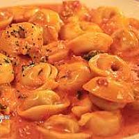 tortelini cream tomato sauce and cheese