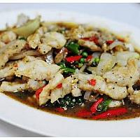 Fried crocodile with black pepper