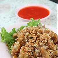 Fried crocodile with garlic