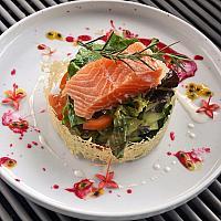 Salmon confit with fresh veggies and sauce vinegar