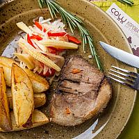 Grilled roasted pork with fried potato, onion and mushrooms