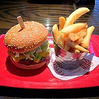 Cheese burger with Lettuce,Tomato,Marinated onion, Mayo and French fries