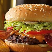 Cheese and Bacon burger with Lettuce,Tomato,Marinated onion, Mayo and French fries