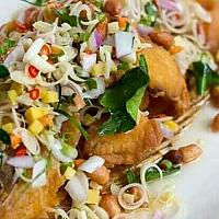 Deep fried fish with herbal sauce ปลาสมุนไพร