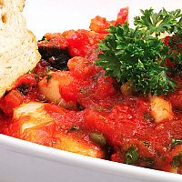 Fresh Tuna with Olives and Capers in tomato sauce
