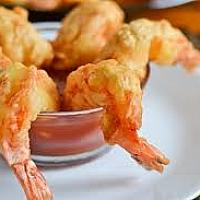 Lightly battered prawns with dipping sauces. 5-6 pieces.