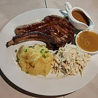 Jumbo pork chop with apple sauce & a choice of sides