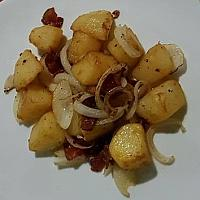 Saute potatoes with onion and bacon