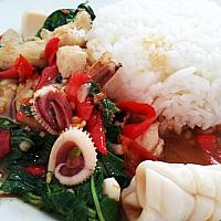 rice topped with stir-fried seafood and basil