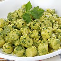 Homemade gnocchi with basil pesto