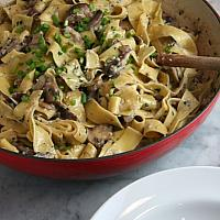Homemade pappardelle with braised beef and creamy sauce
