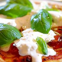 Pizza with burrata and parma ham (pizza available after 1 pm)