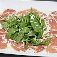 CARPACCIO Fine sliced raw beef with rocket & Parmesan cheese