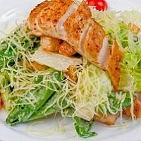 Ceaser salad with white meat of young poultry