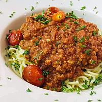 Spaghetti or tagliatelles with bolognaise sauce