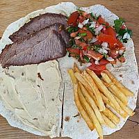 Tortillas hummus and salad sandwich