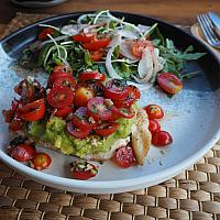 Grilles chicken with mozzarella cheese topped with pesto & tomato salsa served with salad.