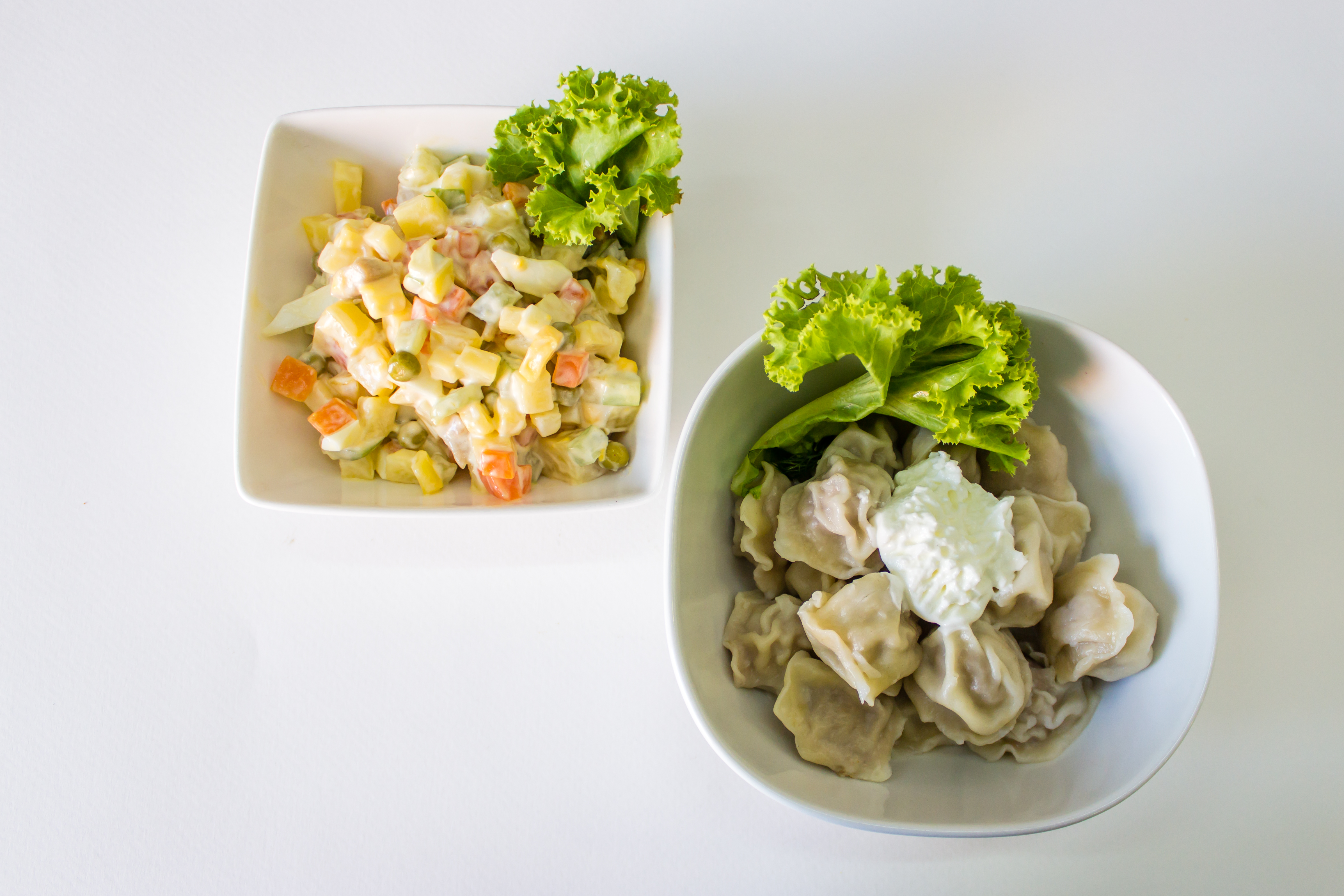 Boiled dumplings (Pelmeni) and Russian salad