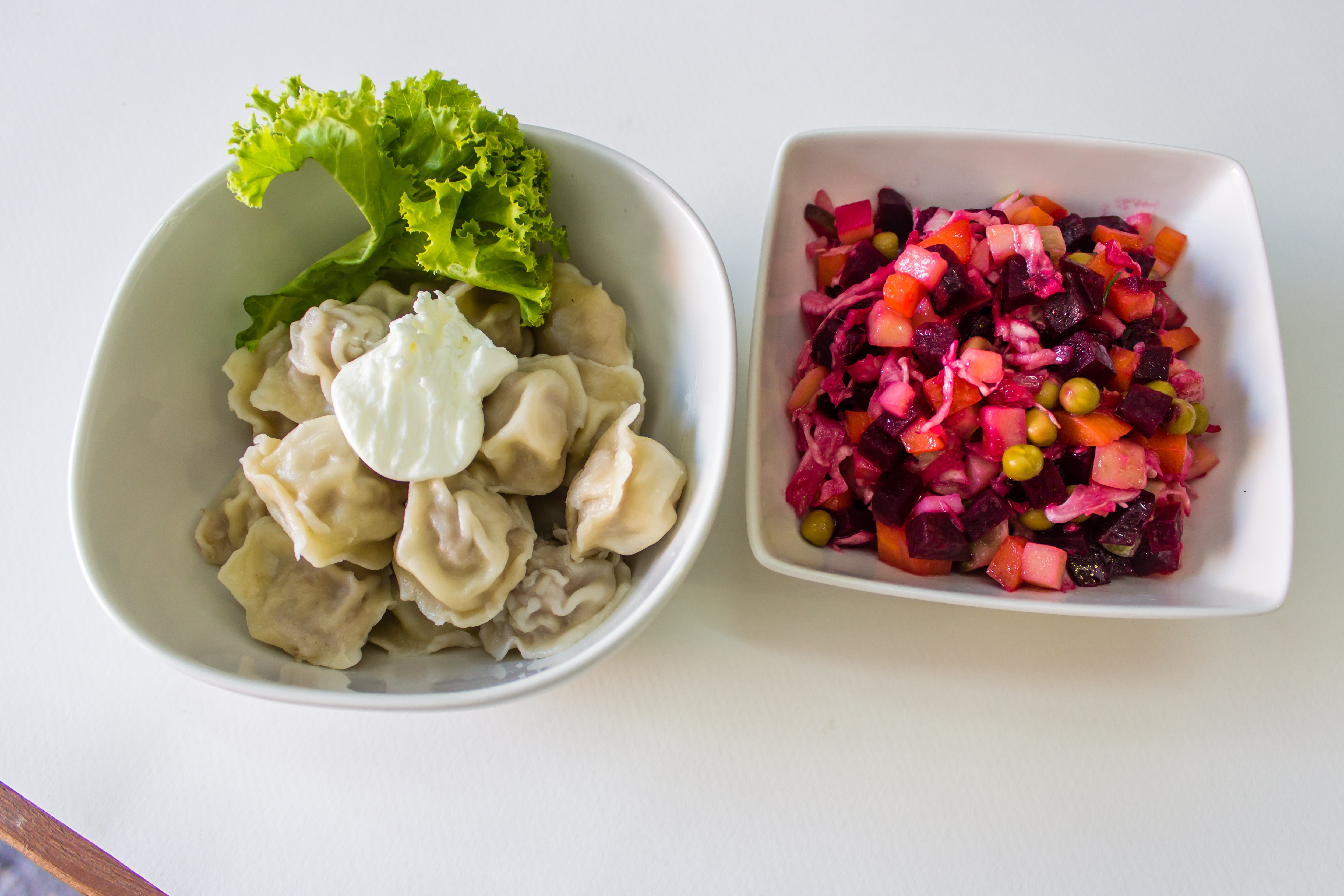 Boiled dumplings (Pelmeni) and vinegert beetroot salad
