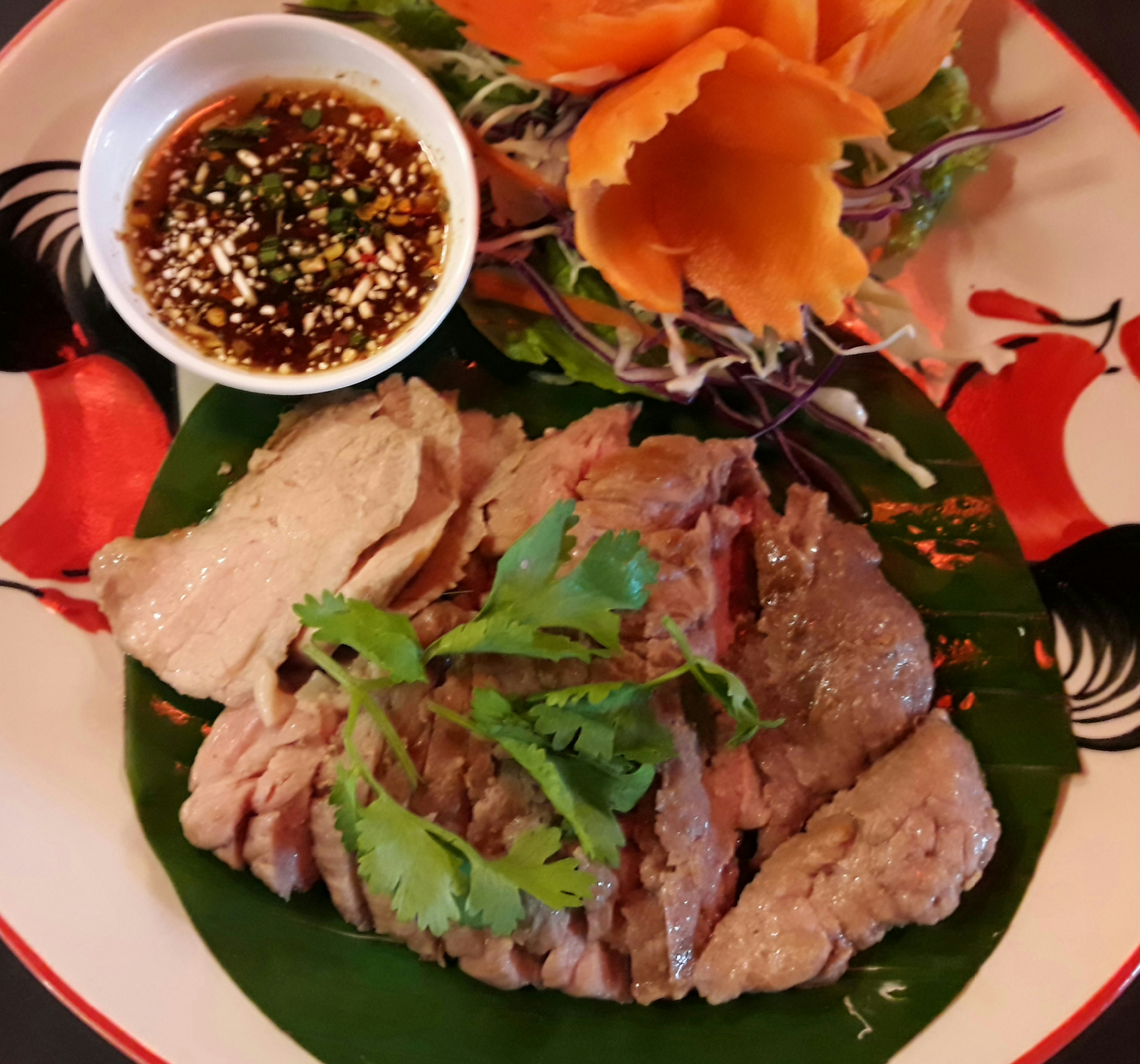 Grilled Pork neck with chili sauce ./คอหมูย่าง