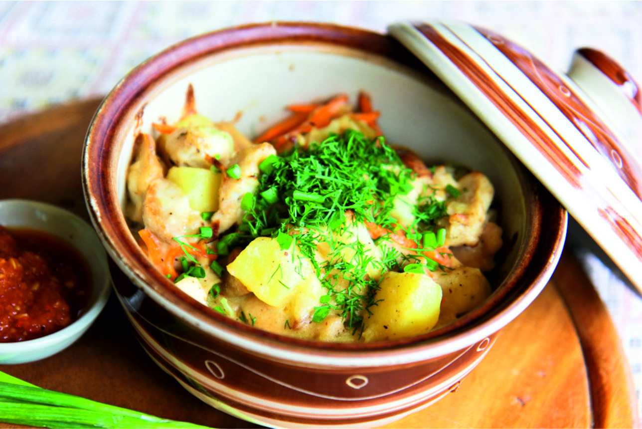 Traditional baked clay pot with potato