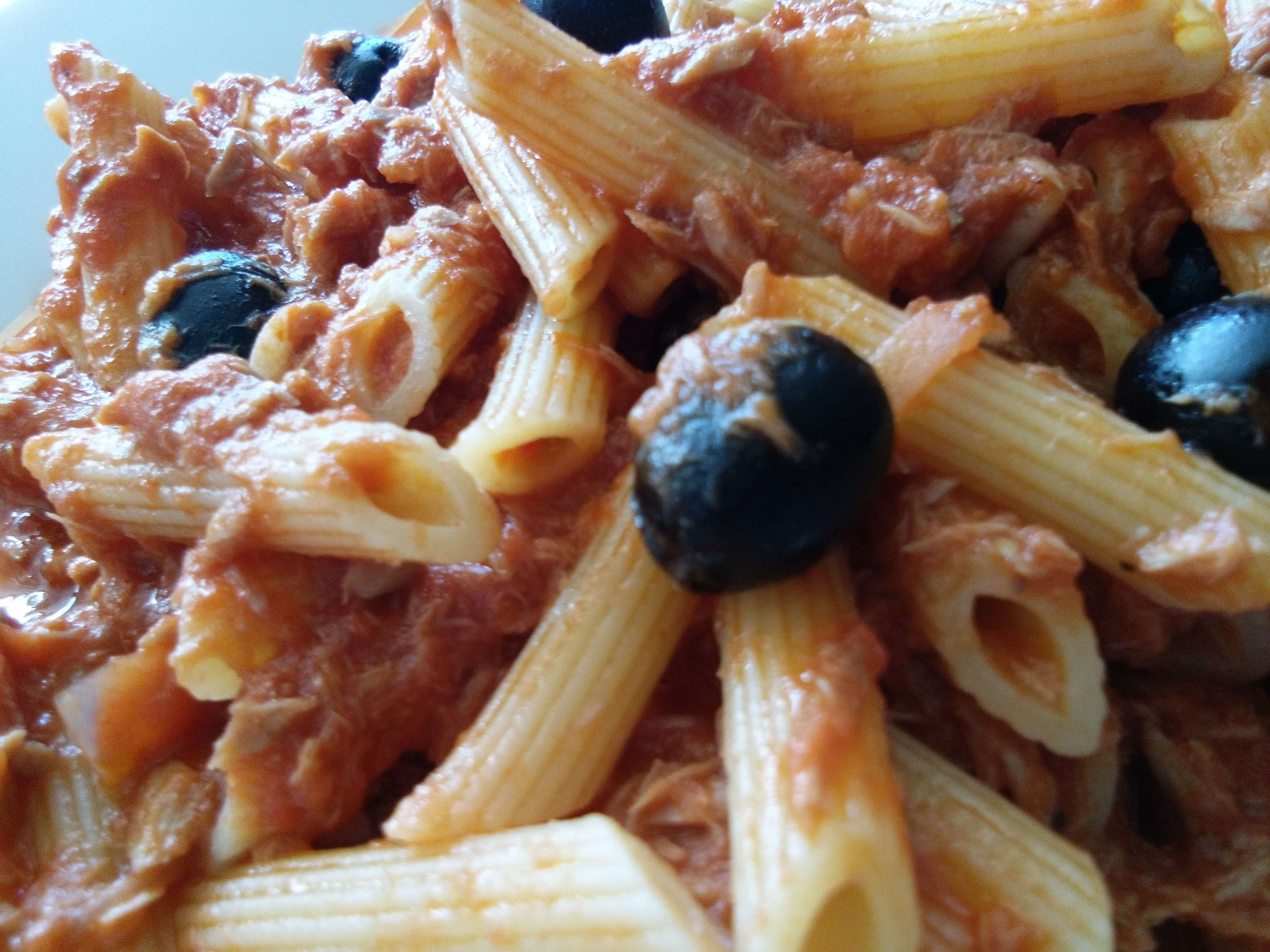 penne with tuna, black olives in tomato sauce